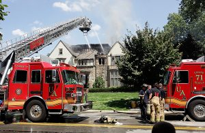 Firefighters pour water on a house fire on Tremont Ave in Upper Arlington August 16, 2011.
