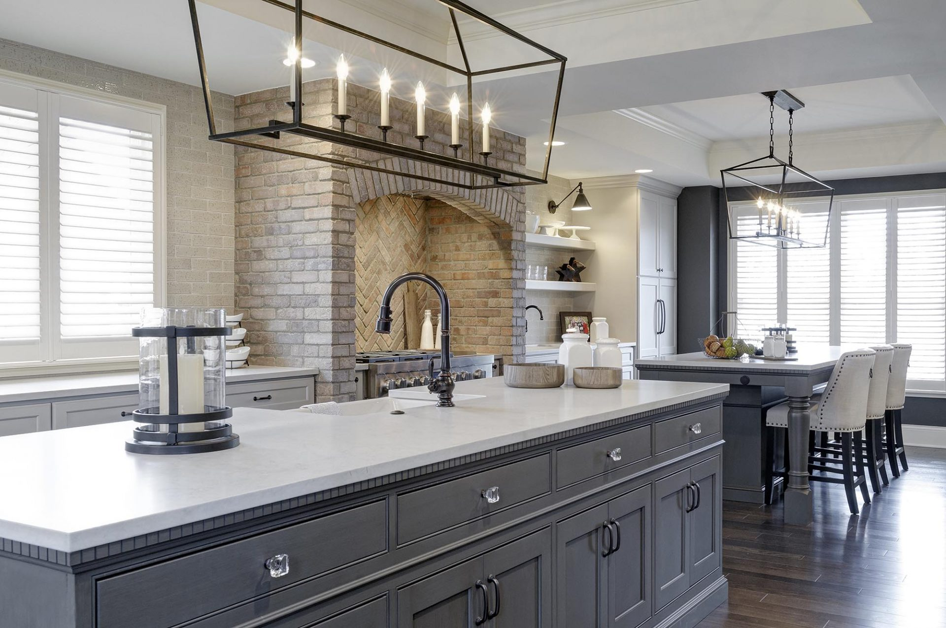 Kitchen renovation, Powell, Dave Fox, Remodel, chandelier, thin brick, large over sized island, quartz, shelving, brick range, white cabinets