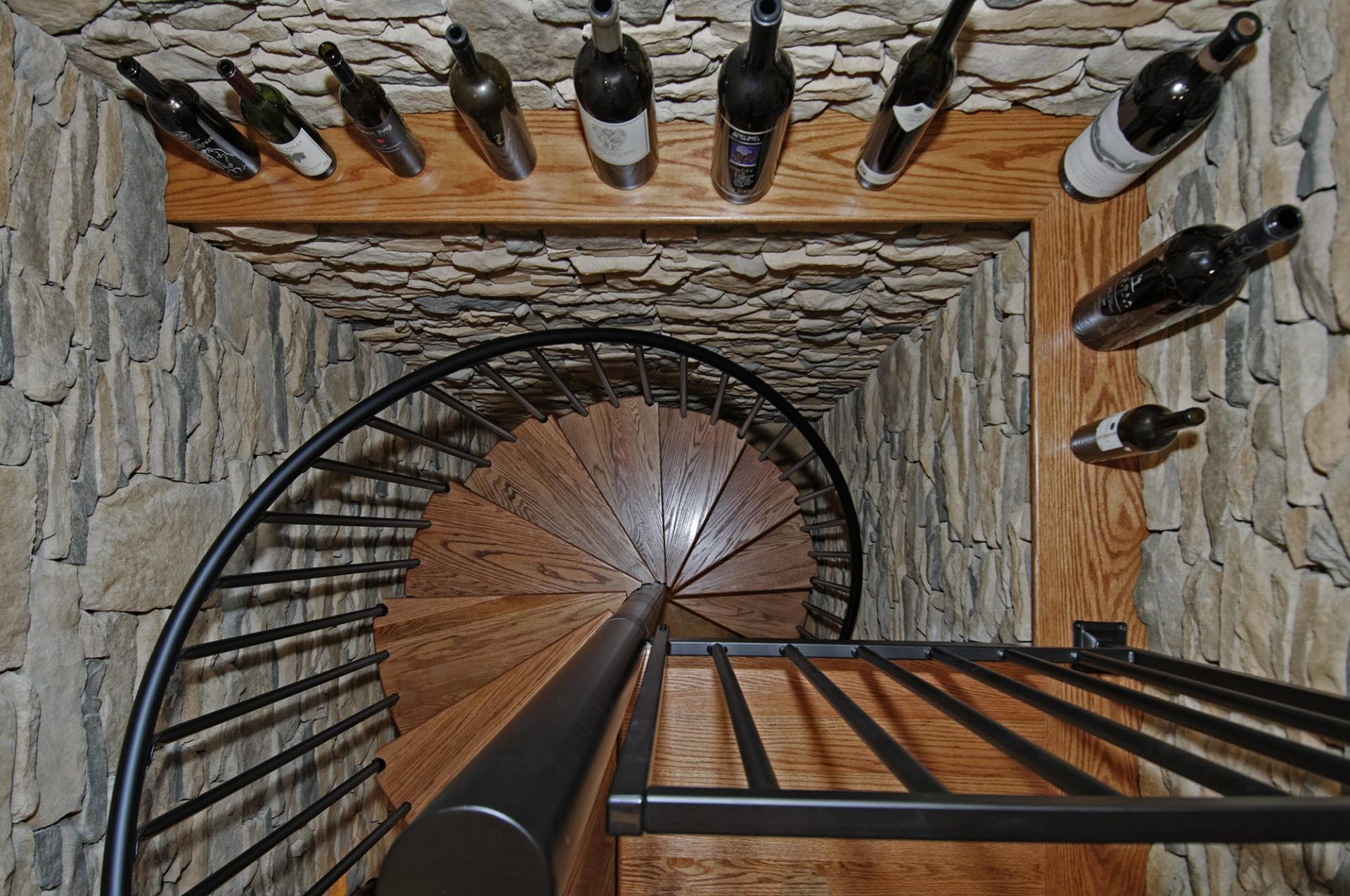 Wine cellar, Powell, Dave Fox, Remodel, spiral stairs, stacked stone, iron, wine racks