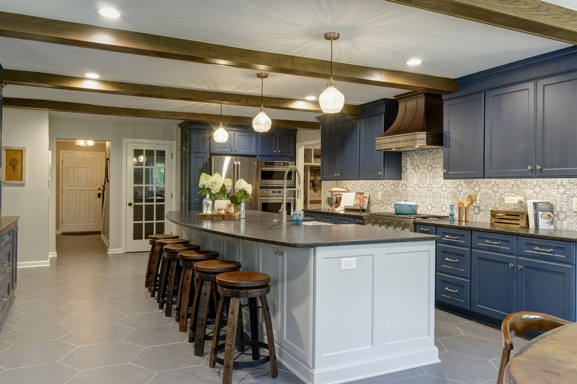 Kitchen remodel, Powell, Dave Fox, Remodel, over sized island, two-tone cabinets, concrete counter, wood beams, apron sink