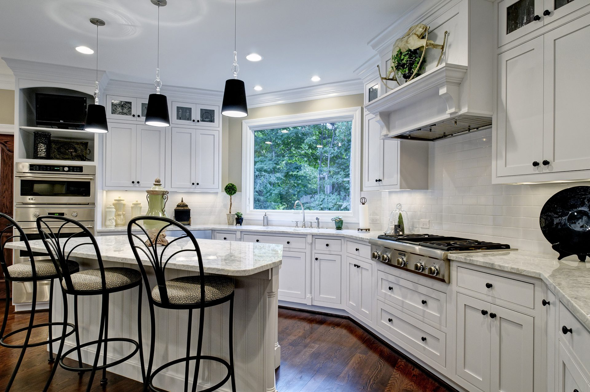 Kitchen, Westerville, Dave Fox, Remodel, white cabinets, black accents, subway tile, gas range, island, bead board, double oven, wood floors, quartz countertop